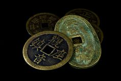 Chinese coins on black Royalty Free Stock Image