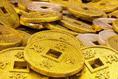Chinese coins. Of gold color shot close-up cues Stock Photos
