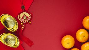 Chinese coins of luck or chinese knot and Chinese gold ingots an Stock Photo