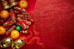 Chinese new year background. Chinese coins luck and firecrackers or chinese knot and Chinese gold ingots and Traditional Foreign text means lucky blessing and Stock Images
