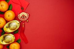 Chinese coins of luck or chinese knot and Chinese gold ingots an Stock Photos