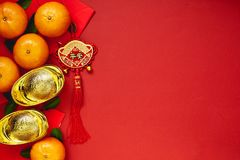 Chinese coins of luck or chinese knot and Chinese gold ingots an Royalty Free Stock Images