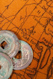 Chinese coins over antique map Royalty Free Stock Photography