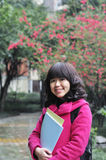 Chinese college girl. Portrait of a chinese college girl royalty free stock photo