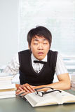 Chinese college male awake in classroom Royalty Free Stock Photo
