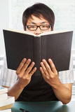 Chinese college male student holding book Royalty Free Stock Photo
