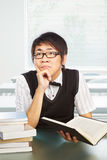 Chinese college male student studying. Seriously in classroom Royalty Free Stock Images