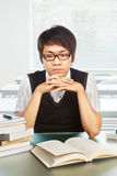 Chinese college male student studying. Seriously in classroom Royalty Free Stock Photos