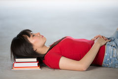 Chinese College Student Sleeping on pile of books Stock Photography