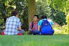 Chinese college students on campus. Photo of chinese college students taking a break on campus grounds photo taken 3rd july 2014 and ideal for teen friends Royalty Free Stock Photography