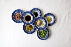 Chinese cooking ingredients in small blue and white bowls stock photos