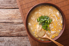 Chinese corn and chicken soup in a bowl close-up. horizontal top Stock Images