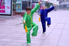 Chinese couple practice Tai Chi in Nanjing Road Shanghai China Royalty Free Stock Image