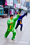 Chinese couple practice Tai Chi in Nanjing Road Shanghai China Royalty Free Stock Photography