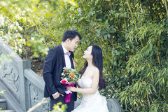 A Chinese couple`s wedding photo who stand on a stone ancient bridge in shui bo park in Shanghai Royalty Free Stock Images