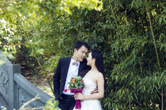 A Chinese couple`s wedding photo who stand on a stone ancient bridge in shui bo park in Shanghai Stock Image
