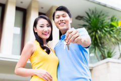 Chinese couple showing keys to their new home Stock Image