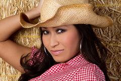 Chinese Cowgirl. Pretty chinese cowgirl in barn Royalty Free Stock Images