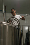 Chinese craft beer brewery. Brewmaster Wang Rui Geezer checking on his beer at his Chengdu Harvest Brewery Royalty Free Stock Photos