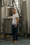 Chinese craft beer brewery. Brewmaster Wang Rui Geezer checking on his beer at his Chengdu Harvest Brewery Stock Photography
