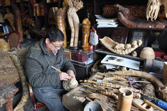 Chinese craftsman making traditional souvenirs Royalty Free Stock Photography