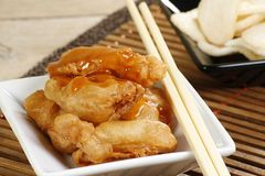 Chinese crispy battered chicken. Crispy battered chicken with chinese sweet and sour sauce and prawn crackers Stock Photos