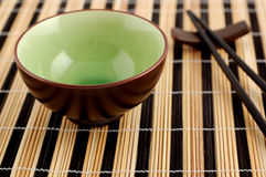 Chinese cuisine. Chinese sticks and bowl for meal Royalty Free Stock Photos