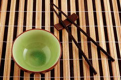 Chinese cuisine. Chinese sticks and bowl for meal Royalty Free Stock Photo