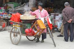 Cooking in the street outdoors,Xingping,China Royalty Free Stock Image