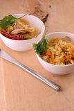 Chinese cuisine - fried rice with meat on wooden background Royalty Free Stock Photos