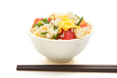 Chinese cuisine - homemade fried rice with tomatoes and egg with chop sticks with clipping path Royalty Free Stock Photography