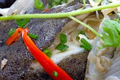 Chinese cuisine – steamed turbot with red pepper and coriander. Chinese cuisine is an important part of Chinese culture, which includes cuisine royalty free stock photos