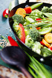 Chinese cuisine. Wok cooking vegetables. Royalty Free Stock Photos
