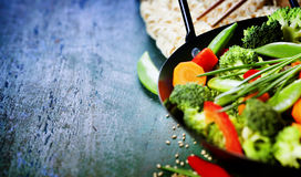 Chinese cuisine. Wok cooking vegetables. Stock Photos
