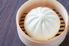 Chinese cuisines steamed bun. Traditional chinese cuisines steamed bun in asian style bamboo basket royalty free stock image
