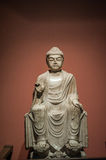 Chinese Cultural Relics:White marble sculpture of sitting Maitreya Buddha Stock Photo