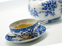 Chinese cup of tea on white. Cup of tea in decorative Chinese cup with pot on white background Stock Images