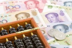 Chinese currencies with abacus Royalty Free Stock Photo