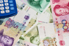 Chinese currency and calculator. Royalty Free Stock Image