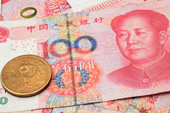 Chinese currency with gold coin. A chinese gold coin on a background of chinese money Stock Photos