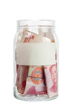 Chinese currency in a jar Stock Photo