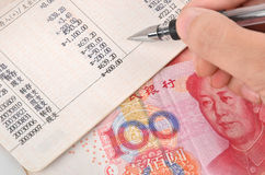 Chinese currency and passbook Royalty Free Stock Images