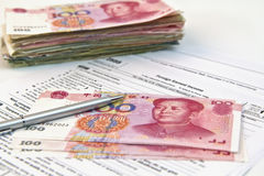 Chinese currency, pen and tax form Royalty Free Stock Photography