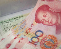 Chinese currency and visa Royalty Free Stock Photos