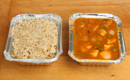 Chinese Curry & Rice Takeaway Meal. Chinese chicken curry and egg fried rice takeaway meal Stock Images