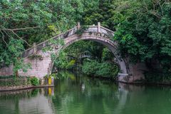 Chinese curve bridge. Chinese style bridge across river in the park Stock Photography