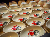 Chinese Cutlery Ceramic Saucer Bowl. Antique Chinese Tableware Ceramic Saucer with Rooster print Stock Photo