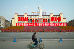 Chinese cyclists and status of maozedong. In Chengdu,Sichuan,China. It lies the center of Chengdu Royalty Free Stock Photos