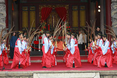 Chinese dance. Children wear Chinese clothes and dance in the ceremony at the Confucian temple on Mar. 1, 2009 in Taiwan. Focus on the temple, slow shutter speed Royalty Free Stock Image
