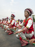 Chinese Dancers. Bai ethnic minority people dance in a dragon parade for the opening ceremony of the Third Month Fair in Dali, Yunnan province, China Royalty Free Stock Images
